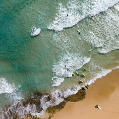 Aerial view of surfers on the beach