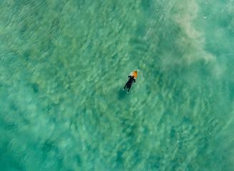 Aerial view of man surfing in the Atlantic ocean