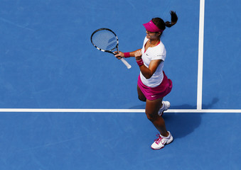Li Na of China celebrates defeating Flavia Pennetta of Italy in their women's quarter-final tennis match at the Australian Open 2014 tennis tournament in Melbourne