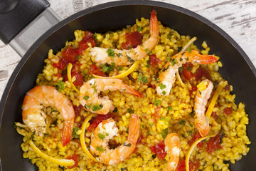 Delicious paella in pan with shrimps.