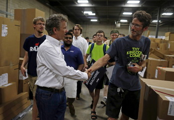 U.S. Republican presidential candidate Senator Rand Paul of Kentucky greets supporters during a campaign stop at Royal Kitchen and Bathroom Cabinets in Niles, Illinois