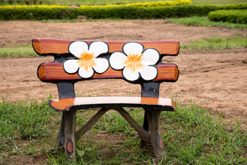 Art bench and flowers in the  garden