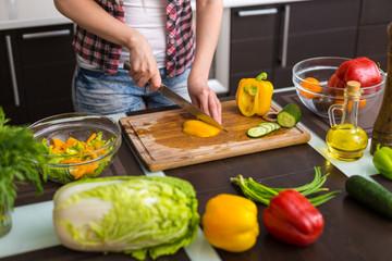 Woman preparing salad in the kitchen