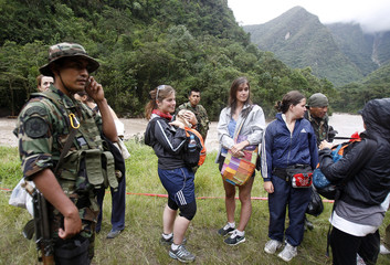 Peruvian police help with the evacuation of tourists by helicopter in Machu Picchu town, in Cuzco