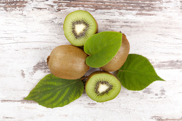 Kiwi on wooden table from above
