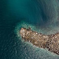 Stony pier in the Ocean.