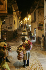 Andean women sell textiles on a street in the city of Cuzco