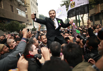 Muslim Brotherhood supporters celebrate outside Egypt's parliament in Cairo