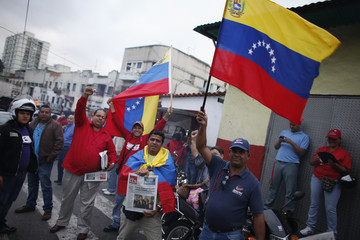 Supporters of Venezuela's President Chavez cheer outside the military hospital after his surprise return to Caracas