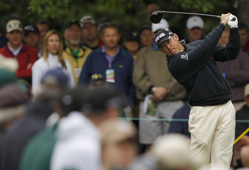 Westwood of England hits his tee shot on the seventh hole during second round play in the 2012 Masters Golf Tournament in Augusta