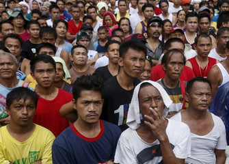 Fans of boxing icon Manny Pacquiao wait for Floyd Mayweather Jr. to be announced winner in the boxing bout at a public park in Marikina city