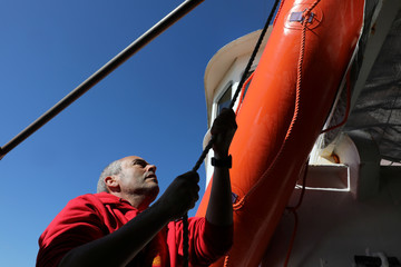 Proactiva lifeguard arranges sea rescue device onto Search and Rescue vessel in Malta