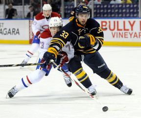 Buffalo Sabres defenseman TJ Brennan battles Montreal Canadiens right wing Brendan Gallagher during the first period of their NHL hockey game in Buffalo