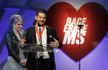 Osbourne smiles as her brother accepts the Race to Erase MS Medal of Hope Award at the 20th annual Race to Erase MS benefit gala in Los Angeles, California