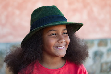 Pretty girl with long afro hair with a elegant black hat