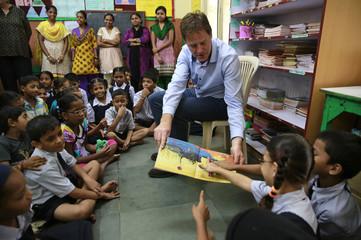 Britain's DPM Clegg interacts with children at Muktangan, a community school in Mumbai