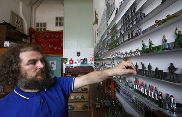 Maker of toy soldiers Timur Zamilov shows his new collection at a workshop in Moscow