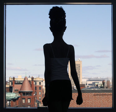 A girl is silhouetted as she practices in the hallway before competing in the World Irish Dancing Championships in Boston