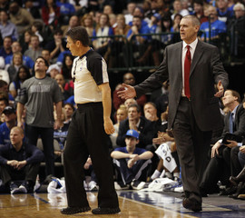 Mavericks head coach Carlisle argues a call with referee Foster as owner Cuban watches the replay against the Heat during their NBA basketball game in Dallas, Texas