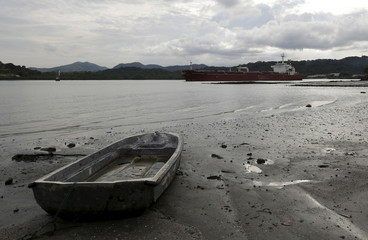 Cargo ship navigates on the pacific side of the Panama Canal in Panama City