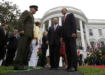 U.S. President Obama leads Mexican President Calderon onto the red carpet during an arrival ceremony at the White House