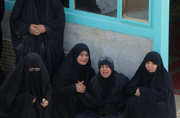 Women mourn a victim who was killed in an attack in Baghdad