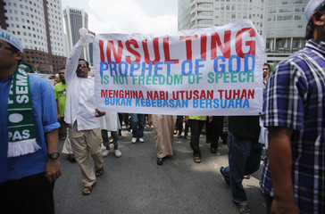 Muslim demonstrators hold up a banner as they march to the U.S. embassy, in Kuala Lumpur