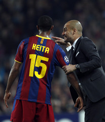 Barcelona's Guardiola gives instructions to Keita during their Champions League match against Shakhtar Donetsk in Barcelona