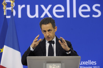 France's President Sarkozy speaks at a news conference at the European Council in Brussels