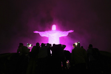 The statue of Christ the Redeemer is lit up in pink for the start of the national campaign Pink October to raise awareness for breast cancer in Rio de Janeiro