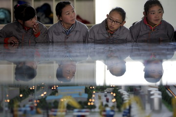Students listen to their teacher as a group of foreign reporters visits a vocational school on a government organised tour in Lhasa