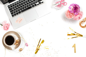 White, gold and pink womens office desk table with a lot of things on it. Top view with copy space.