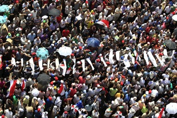 Supporters of Muslim Brotherhood's presidential candidate Mohamed Morsy carry mock coffins during a rally at Tahrir Square in Cairo