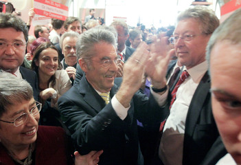 Austria's President Fischer claps his hands after presidential elections in Vienna