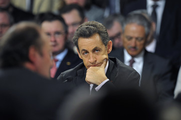 France's President Sarkozy attends a meeting with re-industrialisation authorities in Montmirail, north-eastern France