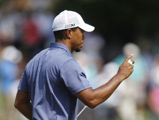 Tiger Woods of the U.S. reacts after his birdie on the ninth hole during the second round of the 93rd PGA Championship golf tournament at the Atlanta Athletic Club in Johns Creek