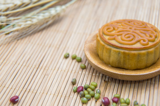 Mooncake, Chinese Midautumn festival dessert with copyspace