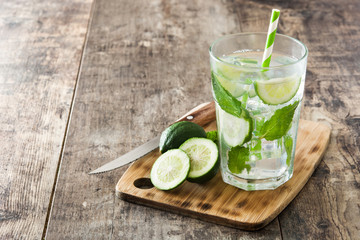 Mojito cocktail in glass on wooden table