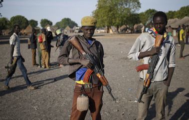 Jikany Nuer White Army fighters stand in a village in Upper Nile State