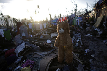 A teddy bear is hung out to dry in a part of Tolosa devastated by Typhoon Haiyan