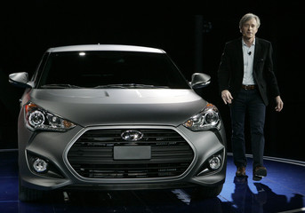 Hyundai's Krafcik stands next to Hyundai Turbo Veloster after it was displayed during the first press preview day for the North American International Auto Show in Detroi