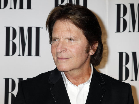 John Fogerty poses as he arrives at the 58th annual BMI Pop Awards in Beverly Hills