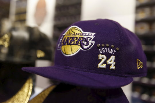 A purple cashmere diamond fitted Kobe Bryant baseball cap on sale for $24,008 is seen in the Lakers store at Staples Center on the last day of Kobe's 20-year career with the team, in Los Angeles