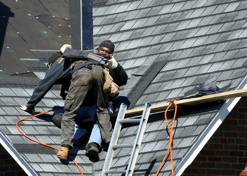 Roofers work on a job site in Washington