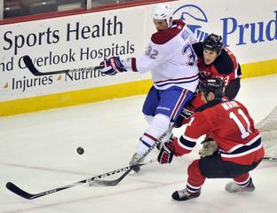 New Jersey Devils Jay Leach and Adam Mair defend against Montreal Canadiens Travis Moen in Newark