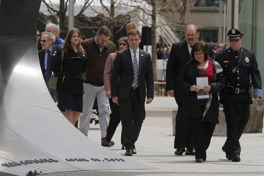 Massachusetts Institute of Technology police officer Sean Collier's mother Kelly Rogers and step father Joe lead family and friends to the newly dedicated memorial for Officer Collier at MIT in Cambridge