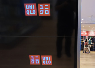 A shopper walks inside Fast Retailing's Uniqlo casual clothing store in Tokyo