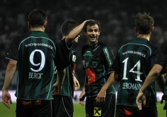 Wacker Innsbruck's Hauser celebrates after scoring a goal during their Austrian league soccer match against Sturm Graz in Graz