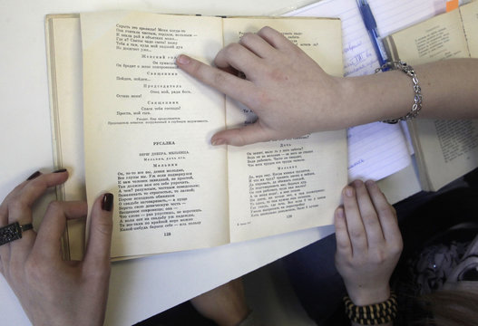 Russian-speaking students learn from a textbook during a Russian literature lesson in Riga