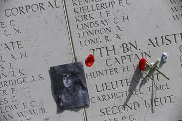 Flowers and a picture of Captain H. Hunter are seen next to his name on the wall of Cape Helles British Memorial before a ceremony to mark the 100th anniversary of the Battle of Gallipoli, in Gallipoli